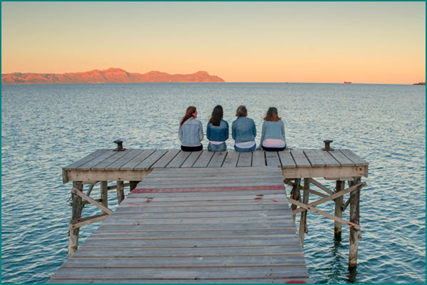 Four women on pier